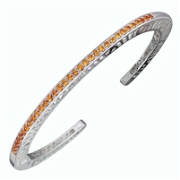 Narrow stacking Bangle. Solid Sterling Silver inlaid with 33 (2ct) 1.7mm Orange Spessartite Garnet Gemstones.Beautiful open work design along the sides with designer, Martha Seely's, signature interlocking spirals. Hinged on one side for good fit. 4mm