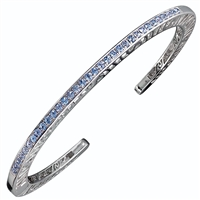 Narrow stacking Bangle inlaid with 33 Swiss Blue Topaz Gemstones (2ctw). Open work design along the side edges - pierced with designer Martha Seely's signature interlocking spirals. Hinged on one side for ease of fit. 4mm Wide. Rhodium plated solid 925 SS