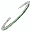 Narrow stacking bangle with 33 rare, Green Tsavorite Garnet Gemstones (2ctw). Open scroll work design on the sides, with designer Martha Seely's signature interlocking spirals. Hinged on one side for ease of fit. 4mm Wide. Rhodium plated 925 SS. size Med