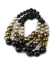 Faceted Black Onyx Gemstones alternate with Bronze Hematite Beads and Cream Pearls. The Gemstones & Pearls graduate in size on this 3-strand, elastic stretch Bracelet. Made in Italy by Rajola. Length aprox 6 1/2""