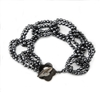 "Bold & beautiful! This Infinity Bracelet features interlocking, double links of faceted, dark Grey, Hematite Beads. Made in Italy by Rajola. It has a Mother of Pearl toggle closure. L 7 1/2"" to 9"" adjustable. Width 1"""