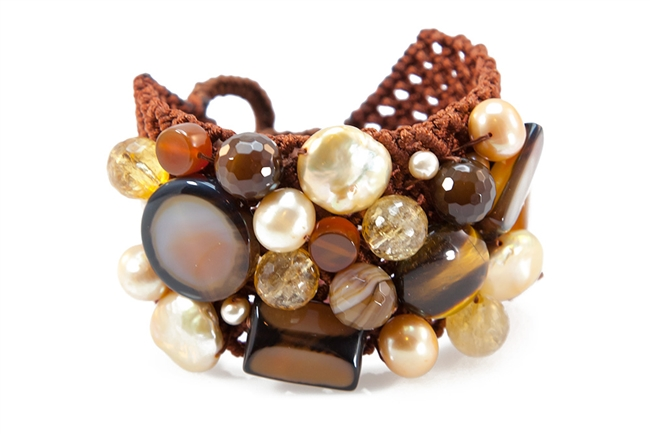 A wonderful medley of Gemstones & Pearls woven onto a cord backing to create this Cuff Bracelet by Rajola. Multiple shapes of Golden Pearls, Tiger Eye, Citrine & Carnelian create this art-to-wear piece. Button closure, adjustable length, fits most wrists.