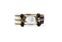"A single, large Baroque Pearl, accented at each corner by Black Onyx Gemstones, is the focus of this Cuff Bracelet by Ziio.  White Seed Pearls create the band with Murano Glass Beads. 925 Sterling Silver Button Closure.  Adjustable in lenght 7"" to 7 1/2"""