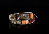 "Ziio's double wrap Boa Bracelet in red & orange is made with shell, turquoise gemstones, tourmaline, brass & Murano glass beads. The bracelet wraps twice around the wrist. Sterling silver button closure is adjustable  in length 14"" to 14 1/2"". 1/2"" wide."