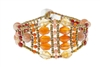 "If you love the warm tones of Summer, this is the Bracelet for you. Ziio's ""Brio"" beaded Cuff features a beautiful blend of Citrine, Orange Carnelian and Pink & Red Agate Gemstones. Hand crafted using Stainless Steel wire. Sterling Silver Button Closure,"