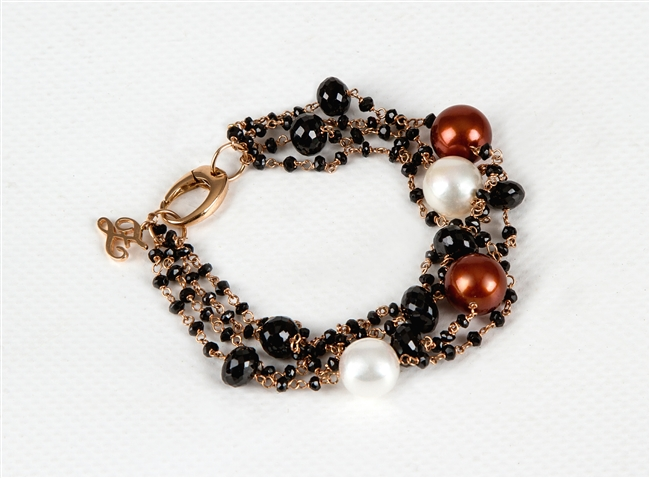 Multi-strand 18k Rose Gold Bracelet by Zoccai. Various sizes of Black Onyx Beads, two White Pearls and two Bronze Pearls add color and style. This is a classic with Italian style. Made in Italy. Lobster Clasp. Pearls are aprox. 11mm