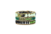 From Ziio's Twilight Collection, crafted in Italy, this wide Cuff Bracelet is a wonderful mix of shades of Green Gemstones and Black Gemstones. Fluorite, Agate, Onyx, Jade, Brass & Murano Glass Beads. 925 Sterling Silver Button Closure, adjustable length