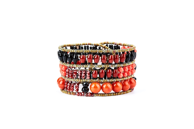 From Ziio's Twilight Collection, crafted in Italy, this wide Cuff Bracelet is a wonderful mix of shades of Red & Orange Gemstones and Black Gemstones. Garnet, Carnelian, Coral, Onyx, Tourmaline & Murano Glass Beads. 925 Sterling Silver Button Closure
