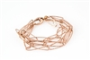 You have to love the glow of the Italians soft Rose Gold next to the skin. This is a five strand chain link Bracelet with long oval textured links in 18k Rose Gold plated 925 Sterling Silver. Large Lobster clasp. length 7 3/4""