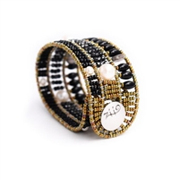From Ziio's Fenice Collection - this Cuff Bracelet features a medley of Black Gemstones. Blue Onyx, Tourmaline & Spinel Gemstones are accented with White Pearls in this linear design. Made with Murano Glass Beads on Stainless Steel Wire. made in Italy