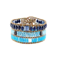 From Ziio's Fenice Collection - this Cuff Bracelet features a medley of Blue Gemstones. Blue Lapis, Kyanite & Zircon Gemstones are accented with Black Spinel & White Pearls in this linear design. Made with Murano Glass Beads on Stainless Steel Wire.