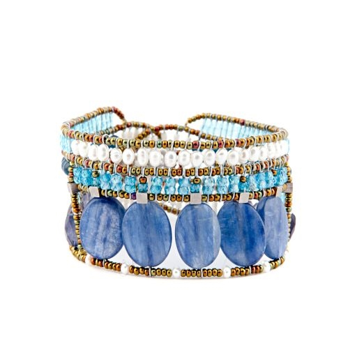 "From Ziio's new Spring/Summer Collection the ""Goiaba"" Cuff Bracelet is done in Blue Kyanite, Iolite, Apetite & Zircon Gemstones. Accented with White WaterPearls and Murano Glass Seed Beads. On stainless steel wire with a Sterling Silver Button Closure"