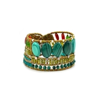"From Ziio's new Spring/Summer Collection the ""Goiaba"" Cuff Bracelet done in Green Malachite & Zircon Gemstones. Accented with Jade, Red Onyx and Murano Glass Seed Beads. On stainless steel wire with a Sterling Silver Button Closure. Width 1 1/2"""