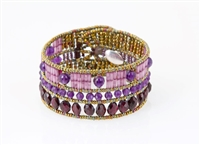 Add a touch of color to your wardrobe with this linear designed Cuff Bracelet by Ziio. It features a harmonious blend of Purple Amethyst & Red Garnet Gemstones for a hint of color, yet a neutral look. Hand crafted in Italy on stainless steel wire