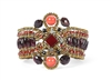 Ziio's Knott Bracelet, a medley of Reds - Garnet, Carnelian, Coral(simulated) & Zircon Gemstones create a visually stunning Cuff. Accented with Murano Glass Seed Beads. Handcrafted on stainless steel wire. 925 Sterling Silver Button Closure, adjustable
