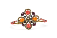 Ziio's small Knott Bracelet.  Garnet, Carnelian, Coral(simulated) & Zircon Gemstones create a visually stunning Cuff. Accented with Murano Glass Seed Beads. Handcrafted on stainless steel wire. 925 Sterling Silver Button Closure. Adjustable in Length