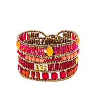 "Ziio's Liberty Bracelet done in shades of Red, Orange & Pink. This beaded Cuff Bracelet features Carnelian, Coral, Brass & multi-color Murano Glass beads. Sterling silver button closure, adjustable in length 6 1/2"" to 7 1/4"" wide. Made in Italy