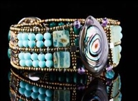 "Ziio's Marquise Cuff Bracelet with Abalone at the center surrounded by Turquoise Gemstones, Brass & Murano Glass Beads. Sterling Silver Button closure adjustable in length from 6 1/2"" to 7"". 1 1/4' Wide."