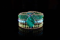 A stunning Bracelet from Ziio's Extraordinaire Collection.  The beautiful medley of Green Gemstones - Jade, Malachite & Peridot - glows next to the complimenting blues of Lapis & Turquoise. It is hi-lighte with a large Malachite Gemstone at the center.