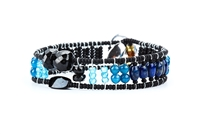 From Ziio's Twilight Collection. This narrow tennis Bracelet is a beautiful blend of various hues of Blue outlined in Black. Lapis, apatite, Zircon, Black Tourmaline & Murano Glass Beads. 925 Sterling Silver Button Closure, adjustable in length.