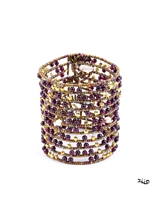 perfect for any occasion. This Bracelet by Ziio features White Seed Pearls, Ruby Red Garnet Gemstones & Gold Beads in a random mixed pattern. Cuff has two Sterling Silver Buttons for closure that make it easy to adjust the length. Hand crafted in Italy