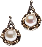From Brenda Smith's Black & Gold Collection - These beautiful Pearl drop Earrings are sure to get attention. Crafted in Oxidized/Blackened Sterling Silver with 18k Yellow Gold accents framing 10mm White Pearls. White Diamond accents of 0.15ctw. Posts.