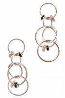 A Trebor Style exclusive - These long Chandelier Earrings are anything but boring. They feature multiple laser cut Sterling Silver rings of various sizes that are enhanced with smaller rings inlaid with White & Black Cubic Zirconia.