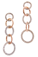 Perfect for that special evening out! These long Chandelier Earrings feature three rings, graduating in size, that are embellished with White Cubic Zirconia. Two Rose Gold plated rings, laser cut, add an accent color in between. 925 Sterling Silver.