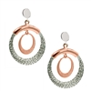 Contrasting White & Rose Gold plated Sterling Silver Circle Drop Earrings by Frederic Duclos. A single Rose Gold ring surrounded by larger White Sterling rings that have been laser cut for visual interest & sparkle. Rhodium plated. Posts. L 1 1/4""