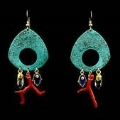 These chandelier earrings feature 3 charm drops - a vintage Red Coral branch, Quartz Crystal points, and Hamsa - all suspended from a Blue patina Brass plate.  On 14k gold filled sterling silver and nickel free ear wire.  Hand crafted in the U.S.
