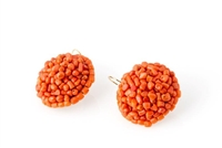 Rajola's Maya Earrings are large button drops in Sciacca Coral. Tiny Coral Nuggets are woven onto a sphere to create this dramatic effect. Crafted in Italy, 18k Gold