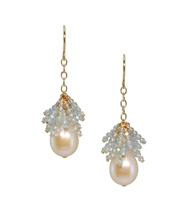 "A beautiful White Fresh Water Pearl with a starburst of Sky Blue Aquamarine Gemstones above.  These drop Earrings are made in gold filled Sterling Silver by Silver Pansy. Made in the U.S. L 1 1/2"" W 1/2"""