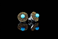 These Button Earrings by Ziio will make a wonderful addition to any wardrobe. A single Blue Magnesite Gemstone is surrounded by two rows of golden Murano Glass Beads. 925 Sterling Silver back & Post. Made in Italy. Dimension 5/8""