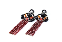 Beautiful long Tassel Earrings in Black & Red by Ziio. The posts feature Black Tourmaline Gemstones with Coral Glass Beads holding four Tassel drops of Rust Red Zircon Gems. Sterling Silver Posts. Hand crafted in Italy.
