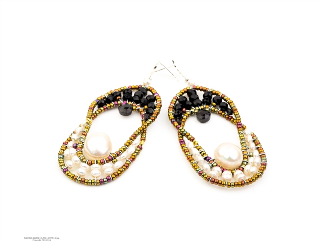 Ziio's Elisse drop Earring is a design that will never go out of style. The oval Chandelier Earring compliments every face structure. Open at the center, the top is beaded Black Onyx Gemstones and has a single Onyx Teardrop. The bottom is in White Pearls
