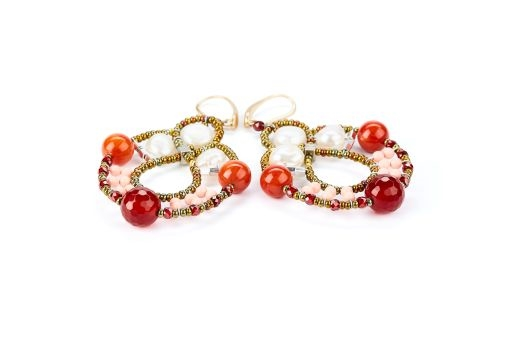 "Galaxie chandelier Earrings are done in White Water Pearls, Red Agate Gemstones, Red Zirconia & imitation Coral Beads. Murano Glass Beads on Stainless Steel Wire create the design and shape.Gold plated 925 Sterling Silver Posts. L 2 3/4"" X W 1 1/2"""