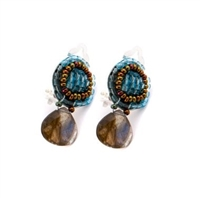 This small Drop Earring by Ziio is perfect for every day. The top button is Beaded with a complimenting combination of Azure Blue & Golden Murano Glass seed beads. It holds a single, faceted Labradorite Gemstone drop. 925 Sterling Silver Posts