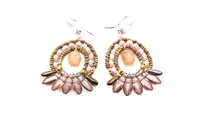 From Ziio's Mistinquett Collection, these Art Deco Drop Earrings are like no other. A center drop of a Peach Moonstone is surrounded by Coral Gemstones and complimented by a fan like effect of Gold Bohemian Glass Beads and accented by Murano Glass Beads.