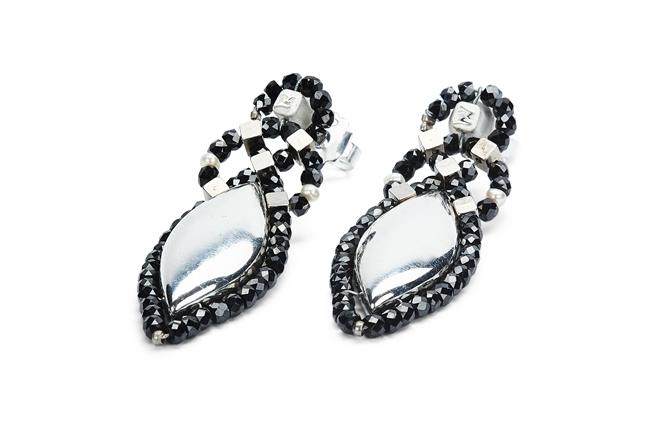 From Ziio's Shine Collection. A large Sterling Silver Bead is surrounded by the contrast of Black Zirconia Beads. Two White Seed Pearls are added for accent. 925 Sterling Silver, rhodium plated. Posts.