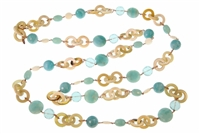 "Extra long natural Tan Horn Necklace randomly accented with Turquoise Chalcedony & Quartz Gemstone Beads, Crystal and Mother of Pearl. Rose Gold plated Sterling Silver Chain links. Snap Clasp. Length 56"". Made in Italy by Amle"