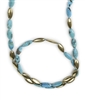 "A perfect Necklace for the Turquoise lover in you. Long Turquoise Gemstone Necklace alternates with brushed Gold plated Sterling Beads in the same shape & size as the Gemstones. Wear long or doubled. Made in Italy by Anticoa. Length 42"", width 10mm."