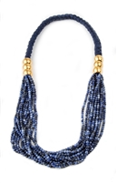 A wonderful Blue Sodalite Statement Necklace by Anticoa. Multi-strands of Sodalite Gemstones are held at the sides with brushed Gold Plated clasps. The neckband is braided navy silk cord. Wear it long or asymmetrical. Fits over the Head. Made in Italy.