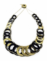 Unique & stylish, this Black Onyx Gemstone & Gold Ring Designer Necklace is one that will never go out of style. Hand crafted, graduating rings of polished Black Onyx alternate with Gold Plated rings. They are connected with strands of gold beads.