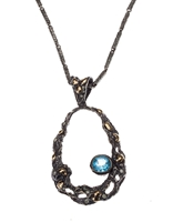 "A beautiful natural Blue Zircon & White Diamond Pendant Necklace by designer Brenda Smith, from her Black Lace Collection. Crafted in dark oxidized Sterling Silver with 18k Yellow Gold accents. 2.5ctw Blue Zircon, 0.25ctw White Diamonds. Chain 18""."