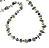 "The irregular Gemstone shapes and mix of color give this Necklace it's unique appeal. Green Serpentine stone Beads complimented by the Purple Amethyst Gemstones. 925 Sterling Silver chain & slide clasp. Length 36"". Stones vary from 3/8"" to 1"" in width"