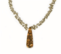"Tiny seed beads of Smokey Quartz Gemstones fill the Gold filled chain and hold a triangular Pendant of Petrified Coral. Made in the U.S. by Elisa Ilana. Adjustable in length from 16"" to 18"". Coral Pendant length 1 3/4"""