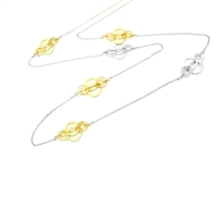 "Delicate Golden Ring Necklace feels like you're wearing lace. Overlapping Gold plated textured rings connected by smaller laser cut rings in white & gold plated. The design alternates in White 925 Sterling Silver. Width 3/4"", Length 34"""