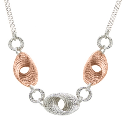 "The movement & depth in this two-tone Cyclone Twist Necklace is amazing. Done in 925 Sterling Silver, accented with Rose Gold plating and laser cutting. Lobster Clasp. Double chain at the Neck. Length 18"" to 20"" adjustable."