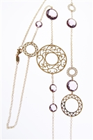 Long, 18k Rose Gold Chain Necklace. Multi-sized, laser cut, Gold rings are like pieces of lace floating in air. The multi-sized, bezel set, faceted Amethyst Gemstones are the perfect neutral.  Wear alone, double or layer with other pieces. Made in Italy