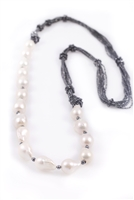 "Rajola's long Forever Necklace in large,White Baroque Pearls & Hematite. The multi-strands of Hematite add sparkle & a unique touch to a classic look. 36"" long. can also be worn asymmetrically for a different look. Pearls are aprox. 19mm. Made in Italy."